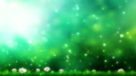 Nature background. Beautiful sun shine through the blowing on wind tree green leaves and flowers. Blurred abstract bokeh with sun flare video