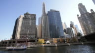 Nautical vessel in river and skyline downtown Chicago USA video