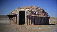 1972: Navajo Native American southwest round housing and people selling jewelry. video