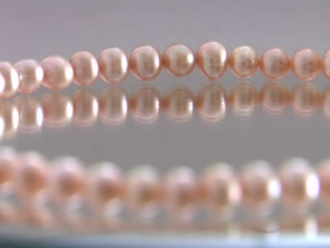 necklace of pink pearls video