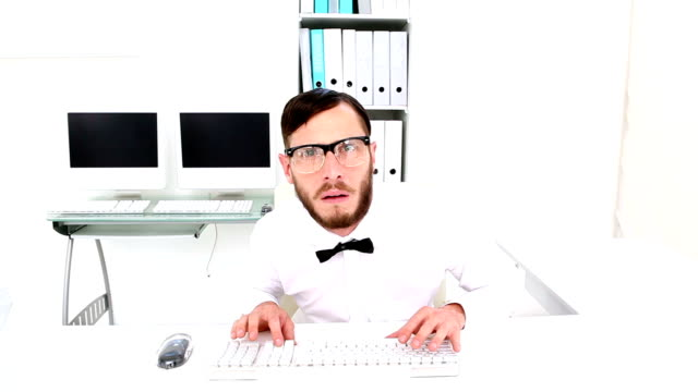 Nerd typing and getting stressed at desk video