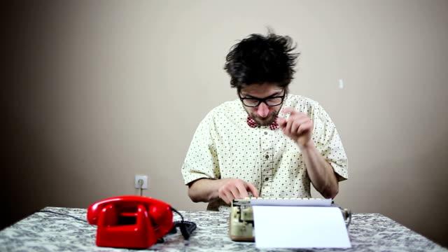 Nerd writer typing on a typewriter video