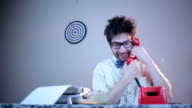 Nerdy guy talking on phone video
