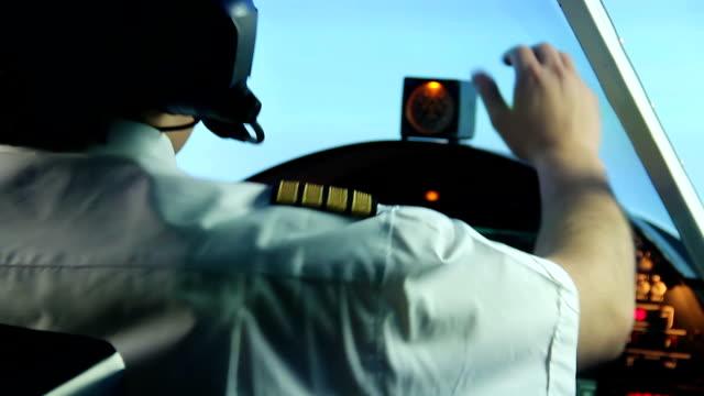 Nervous pilot navigating plane despite turbine engine failure, stressful job video