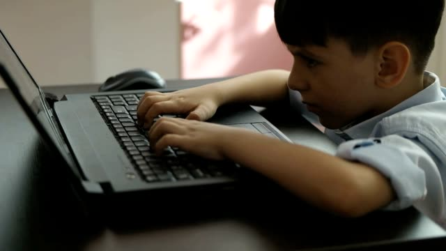 nervous student boy with tablet pc computer video