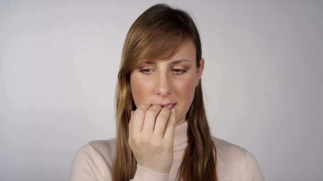 Nervous woman biting her fingernails video