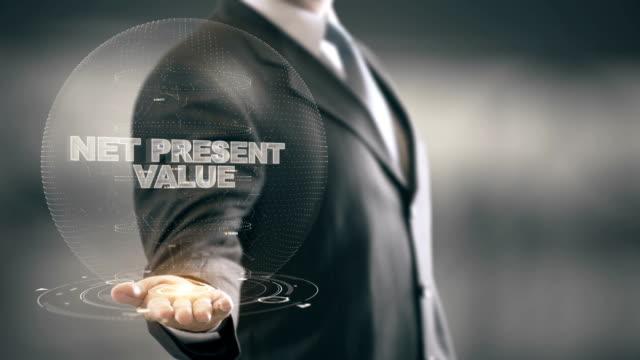 Net Present Value with hologram businessman concept video
