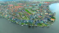 Netherlands Windmill Village Fly Towards Water Front Buildings video