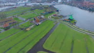 Netherlands Windmill Village, Flyover Field Viewing Homes & Windmills video