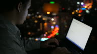 Network engineer working latenight at rooftop of building video