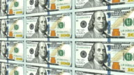 New 100 dollar bills in distance 3d perspective video