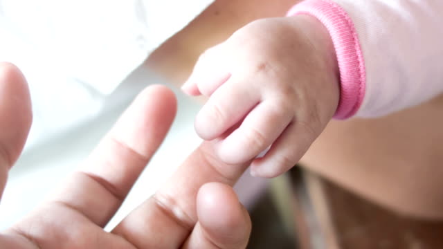 New born baby hand. video