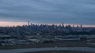 AERIAL: New Jersey industrial zone & New York Downtown Manhattan skyline at dawn video