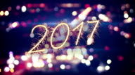 2017 new year sparkler text and city bokeh lights video