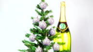 New Year's balls on a New Year tree and a huge bottle of sparkling wine video