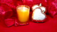 New Year's composition on a red background - ball and ribbon and a candle video