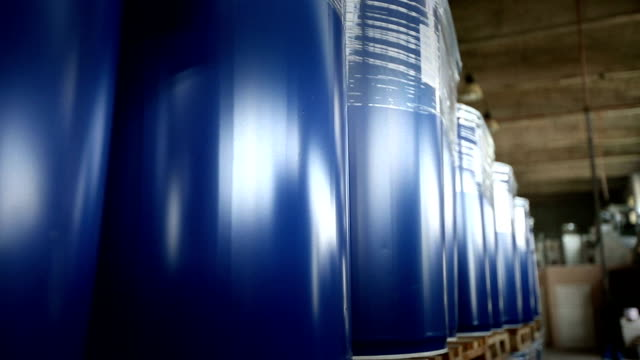 New yellow barrels inside a storage warehouse. video