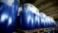 New yellow barrels inside a storage warehouse. video