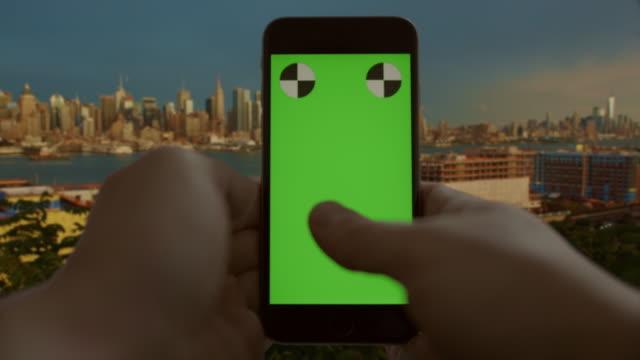 New York City chromakey green screen smart phone texting surfing video