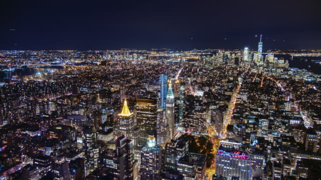 USA, New York City, Manhattan aerial panorama cityscape skyline. Timelapse. Far ahead of the Statue of Liberty can be seen video