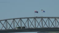 New Zealand National flag and the Silver Fern flag on Auckland Harbour Bridge video