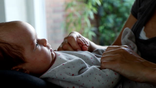 Newborn and mom connecting at home video