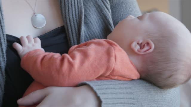 Newborn Baby boy asleep in mother's arms video