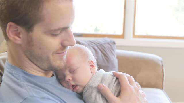 Newborn Baby boy asleep on father's chest video