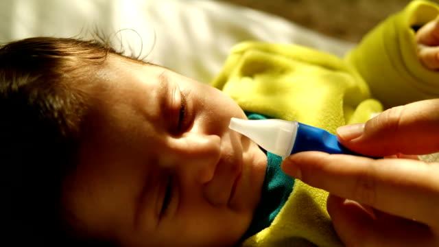 Newborn baby gets nose drops video