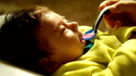 A newborn baby is being given medicine video