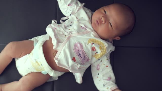 Newborn Baby On Black Leather video
