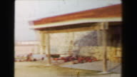 1968: Newly constructed golf clubhouse in barren southwestern USA desert driving carts. video
