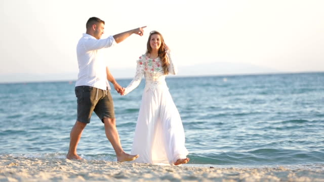 Newlywed walking on the beach video