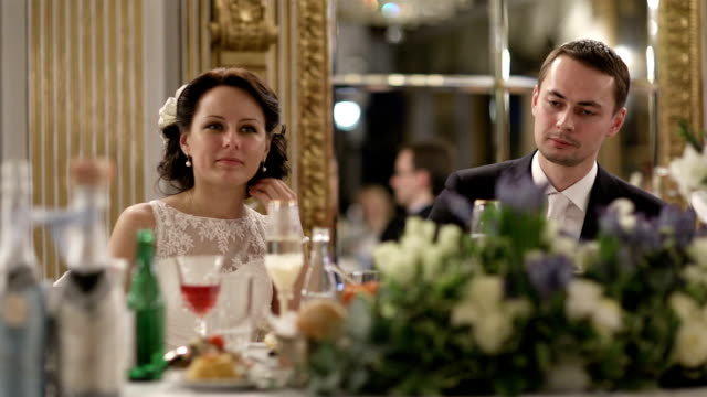 Newly-weds at the festive table. video