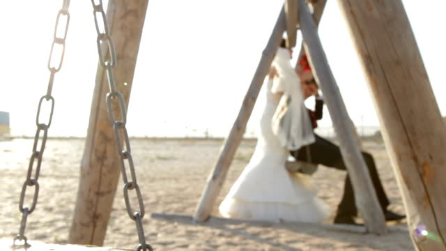 Newlyweds riding on a swing video