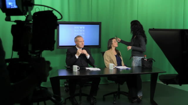 News presenters and make up artist in Television studio video