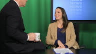 News presenters talking in television studio video