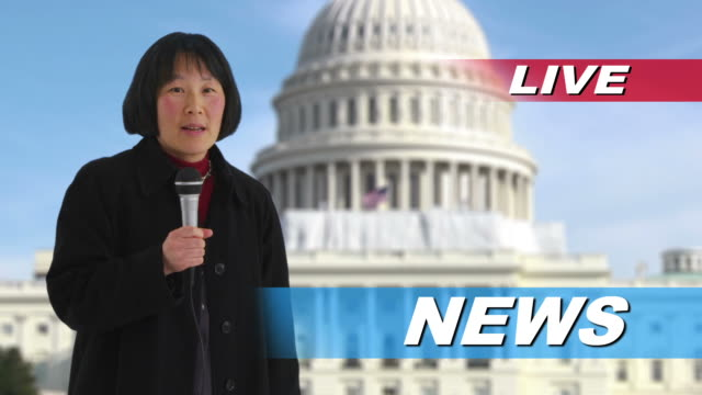 News reporter talking in front of US Capitol building video