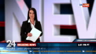 HD: Newscaster Reading The Day's Breaking News video