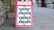 Newspaper headline Board - Credit Crunch causes misery video