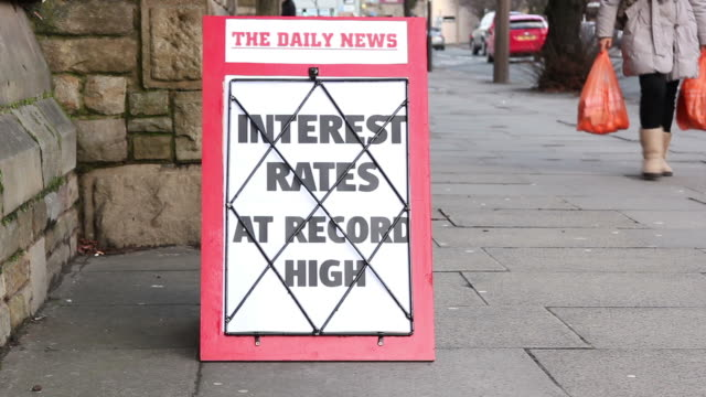 Newspaper headline board - Interest rates at record high video