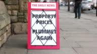 Newspaper headline Board - Property Prices Plummet Again video