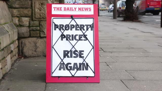 Newspaper headline board - Property Prices rise again video