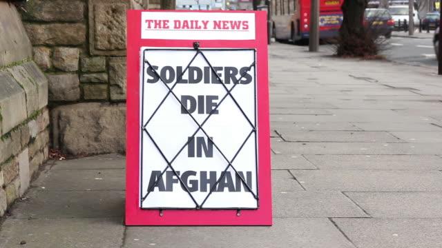 Newspaper headline board - Soldiers die in Afghanistan video