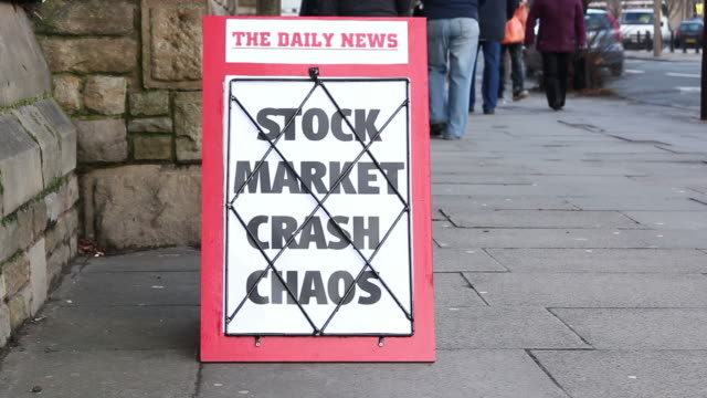 Newspaper headline board - Stock market crash chaos video