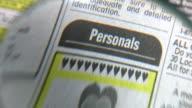 newspaper personals video