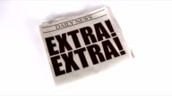 EXTRA! Newspaper Tossed onto White Background and then Picked Up video