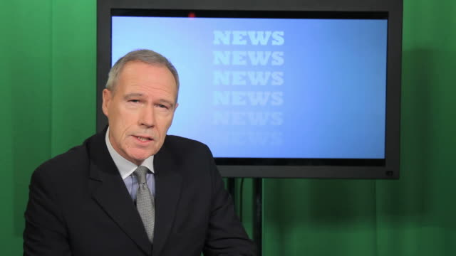 Newsreader in television studio video