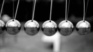 Newton cradle, black and white video