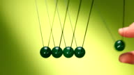 Newton's cradle of green balls video